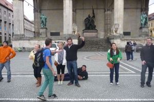 Our tour guide, Chris, making our group pose like the statues